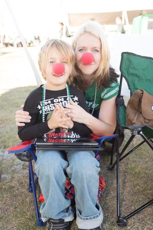 Primary view of object titled '[Mother and Child Wearing Red Clown Noses]'.