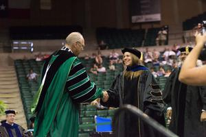 Primary view of object titled '[Graduate and UNT President Neal J. Smatresk Shake Hands]'.