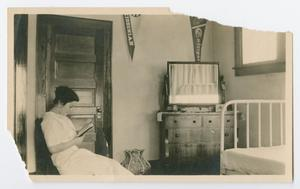 Primary view of object titled '[Photo of Irene Biffle reading a book, from the Byrd Williams Jr. album, 1907-1920]'.