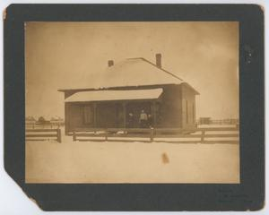 Primary view of [A family on a porch]