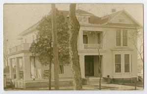 Primary view of object titled '[Photo of the Byrd Williams Sr. home from the Byrd Williams Jr. album, 1907-1920]'.
