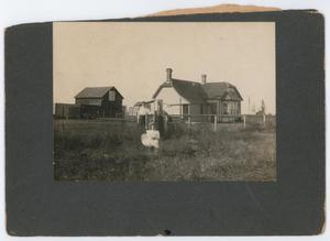 Primary view of object titled '[A family on their homestead]'.