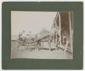 Primary view of object titled '[Four people in a wagon]'.