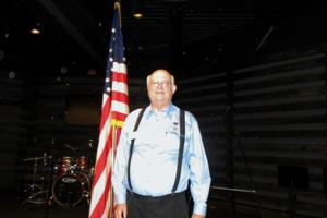 [John Anderson, Jr. with Flag]