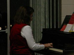 Primary view of object titled '[Donna Arnold Playing Piano]'.