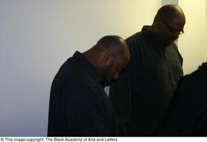 Primary view of object titled '[Rachel Webb, Kirondria Woods, Curtis King, and several other praying in hallway]'.