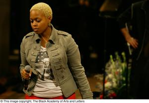 Primary view of object titled '[Chrisette Michele singing on stage]'.