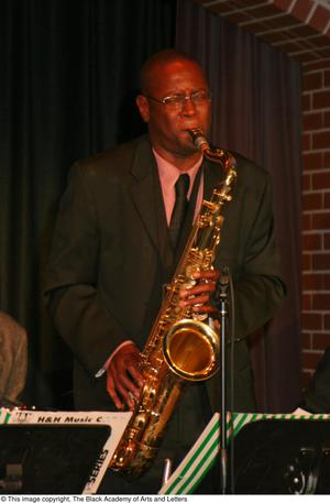 Primary view of object titled '[Saxophonist playing on stage]'.