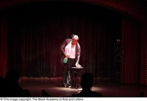 Primary view of object titled '[Performer wiping down table]'.