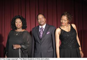 Primary view of object titled '[Benita Arterberry with Yarbrough and Peoples standing on stage]'.