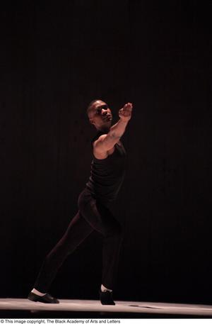 Primary view of object titled '[Dancer in black in spotlight]'.