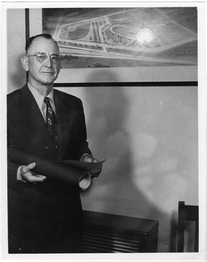 Primary view of object titled '[Theron J. Fouts Beside a Rendering of Fouts Field]'.