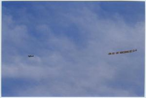 Primary view of object titled '[Plane with banner promoting UNT Homecoming #1]'.