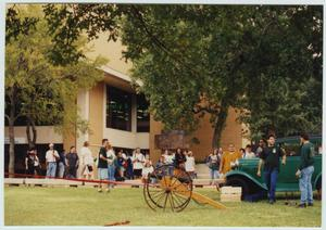 Primary view of object titled '[Students outside the University Union during North Texas Homecoming activities]'.