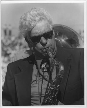 Primary view of object titled '[Man playing saxophone during North Texas Homecoming activities]'.