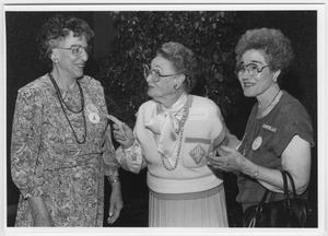 Primary view of object titled '[Three women talking during a North Texas Homecoming event]'.