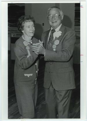Primary view of object titled '[Doyle and Margaret Chrisman at Golden Eagle dance, UNT Homecoming 1991]'.