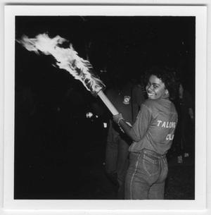 Primary view of object titled '[Talon Club member with bonfire torch, 1983]'.