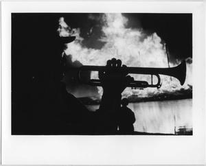Primary view of object titled '[Trumpet player silhouetted against North Texas Homecoming bonfire, 1987]'.