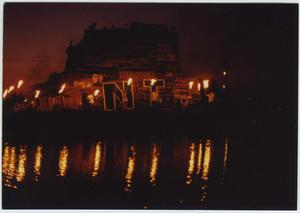Primary view of object titled '[Students with torches surrounding North Texas Homecoming bonfire, 1993]'.