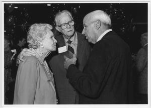 Primary view of object titled '[Zeke Martin talks with Mr. and Mrs. Moore at the North Texas Alumni Homecoming Dance]'.