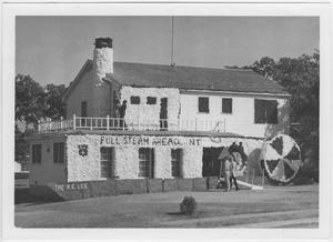Primary view of object titled '[Kappa Alpha house decorated for North Texas Homecoming, 1955]'.