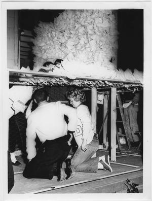 Primary view of object titled '[Kappa Sigma members work on North Texas Homecoming float, 1960]'.