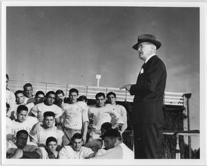 Primary view of object titled '[North Texas President W. J. McConnell addresses football team during Homecoming, 1941]'.