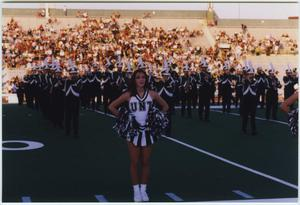 Primary view of object titled '[North Texas marching band and dancers at Homecoming halftime show, 1997]'.