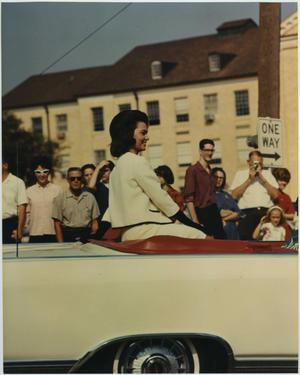Primary view of object titled '[North Texas Homecoming Queen candidate rides through campus]'.