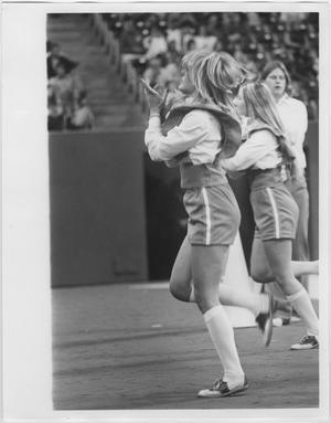 Primary view of object titled '[North Texas State University Cheerleaders at a Game]'.
