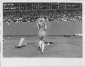 Primary view of object titled '[North Texas State University Cheerleader at a Game]'.
