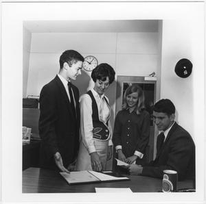 Primary view of object titled '[North Texas Green Jacket with Students]'.