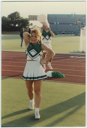 Primary view of object titled '[North Texas Cheerleaders at the Homecoming Game, 1992]'.