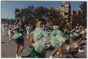 Primary view of object titled '[North Texas Dance Team in the Homecoming Parade, 1992]'.