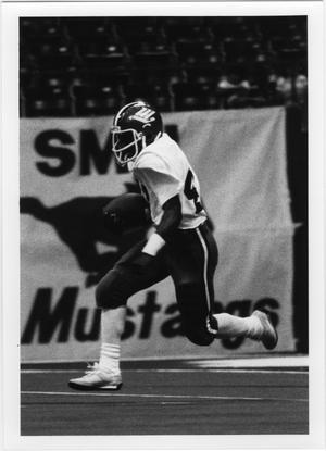 Primary view of object titled '[North Texas Football Player Carrying the Ball]'.