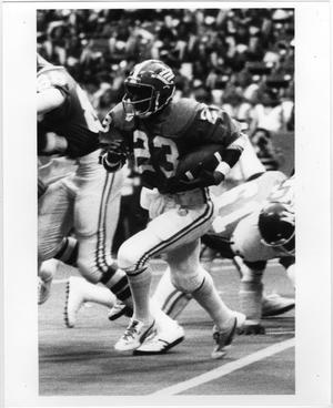 Primary view of object titled '[North Texas Player Rushing the Ball]'.