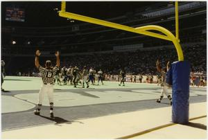 Primary view of object titled '[Referees Signal Touchdown]'.