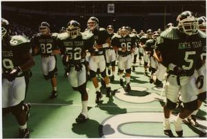 Primary view of object titled '[UNT Eagles Run onto the Field in Texas Stadium]'.