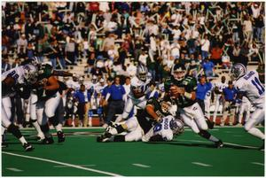 Primary view of object titled '[UNT Carries Ball Against Middle Tennessee State]'.