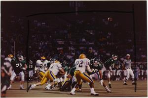 Primary view of object titled '[North Texas Eagles vs. McNeese State Cowboys]'.