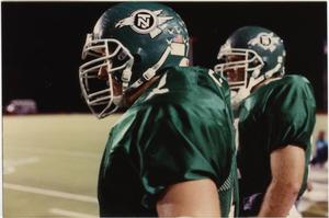 Primary view of object titled '[North Texas Football Players on the Sidelines]'.