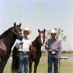 Primary view of object titled '[Shorty and Bill Freeman with Horses]'.