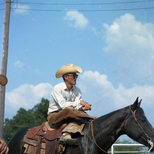 Primary view of object titled '[Cowboy on his horse at Cowtown Daze]'.