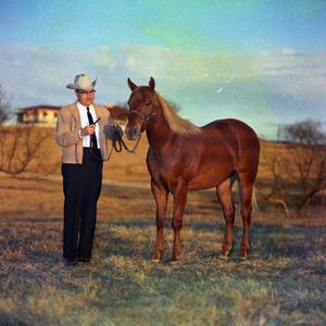 Primary view of object titled '[George Underwood with Horse]'.