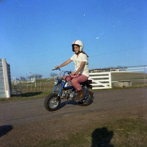 Primary view of object titled '[Woman on Motorbike]'.