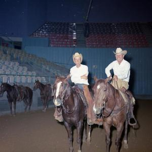 Primary view of object titled '[Two Men at NCHA Tournament of Champions]'.