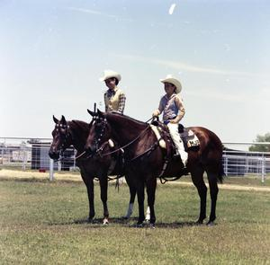 Primary view of object titled '[Two Children with Horses on Wayne Bell Ranch]'.
