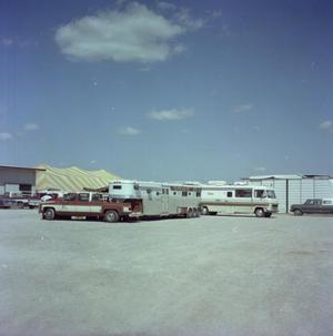 Primary view of object titled '[Photograph of R.V. and Trailer]'.