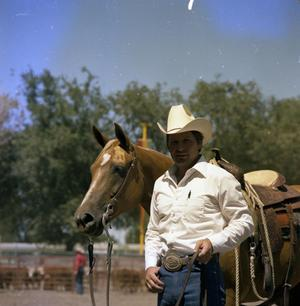 Primary view of object titled '[Man with Horse at Colorado State Fair]'.